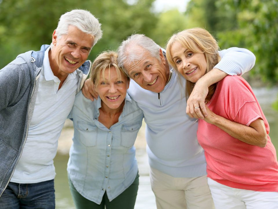 senior couples enjoying time in the woods and by a river